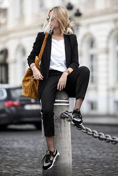 Black blazer, white t-shirt, black track pants, fishnet tights, black sports sneakers, yellow bucket bag - Fall outfits, fall fashion trends 2017, fall fashion, street style, comfy outfits, casual outfits, trendy outfits, back to school outfits, travel outfits.