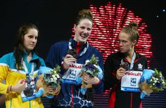 (L-R) Silver medal winner Belinda Hocking of Australia, Gold medal winner Missy Franklin of the USA and Bronze medal winner Hilary Caldwell of Canada celebrate on the podium after the Swimming Women's Backstroke 200m Final on day fifteen of the 15th FINA World Championships at Palau Sant Jordi on August 3, 2013 in Barcelona, Spain.