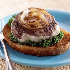 Bull's-Eye Onion Burgers: INGREDIENTS- 1 large sweet onion, 1  pound 95% lean ground beef, 1 1/2 tsp garlic powder, 1/4 tsp salt, 1/4 tsp ground black pepper, 4 slices low fat Swiss cheese (3 ounces), 8 red and/or green kale leaves, stems removed, 2 tsp olive oil, 4- 3/4 slice hearty bread or Texas toast. Veggies, optional. SUPPLIES- Grill, measuring/cutting tools. *30-45 min serves 4 (Grill- 160 degrees)