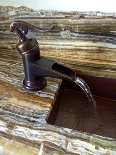 Trough sink w canyon onyx stone.. Beautiful powder room. Interior design by The Heberling Company