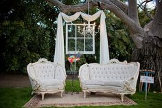 "This was a hit at my wedding! We created an outdoor ""smile station"" at my reception using vintage furniture, an upcycled window, and a chandelier! Reedley, CA"
