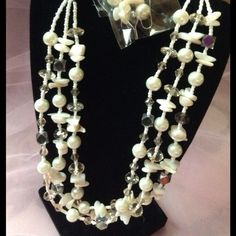 Off White Shell Necklace set Off white shell and beaded necklace with matching earrings. Jewelry Necklaces