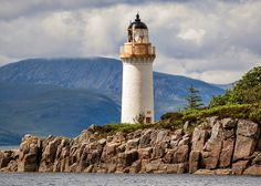 Eilean Bàn Lighthouse under the Skye Bridge, Scotland Harbor Lights, Lighthouse Art, Wish I Was There, Light House, Cn Tower, Us Travel, Biking, Light Up, Scotland