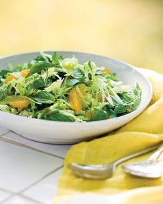 Slaw sheds its frumpy reputation in this lively tangle of basil, parsley, and Champagne vinaigrette. Navel oranges add just the right amount of sweet.