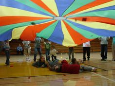 Or you just happen to have a parachute lying around?Check out this bunch of parachute games.perfect for summer programs!// I do lots of parachute games with kids. Pe Activities, Movement Activities, Activity Games, Physical Activities, Activity Ideas, Physical Education Games, Indoor Activities, Summer Activities, Gym Games