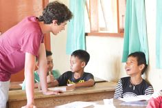 Volunteer Eduardo having fun with his student during class