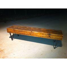 Beam bench with custom metal legs.