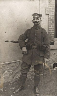 WW1: A Bavarian infantryman strikes a proud pose for the photographer. The manner of carrying the rifle as in this photo was common at the time when not burdened with a full pack. Note the super mustache.