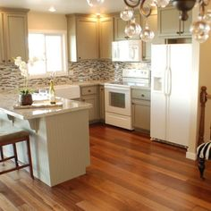 Gray cabinets, white appliances. Planning to do this in my kitchen which has white appliances!