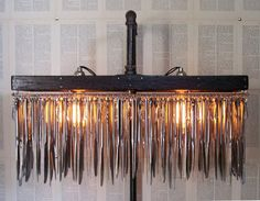 AMAZING!  Upcycled Butter Knife Standing Chandelier by AdamReidDesign, $950.00