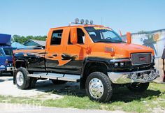 black and orange Hooters GMC pick up Truck