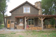 Front Porch Denver for a Rustic Exterior with a Chimney and Fishing Ranch by Coburn Development