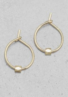 & OTHER STORIES Subtle hoop earrings embellished with a tiny bead.