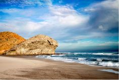 Located in 'Cabo de Gata-Nijar' national park in Almeria, Southern Spain. It has a phenomenal landscape, with lava cliffs and a long black sandy beach.