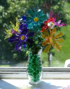 Plastic bottle flowers. Learn how to make this and other items in Dollar Store Crafts & Recipes (Vol. 1).