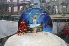 Claire Robertson from Scottish Ballet, poses dressed as the Good Snow Flake inside a life size snow globe on Buchanan Street during a promotion for Scottish Ballet's festive production of The Nutcracker on November 20, 2012 in Glasgow, Scotland. The Nutcracker opens at the Theatre Royal on December the 8th, the production delves deep into the darker reaches of Hoffmann's original tale in a fresh and vivid retelling of the famous Christmas story.