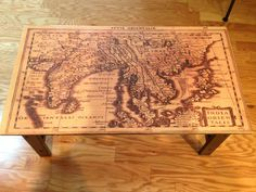 Map-top table DIY. Would be awesome to put a map of the Caribbean (honeymoon locations) or CSB on top of a dresser in the beach room