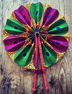 These colorful hand fans are our bestseller. Made out of leather and African print fabric they are a hot accessory for the Summer.