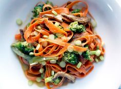Think zucchini noodles are cool? Try a bowl of delicate carrot ribbons bathed in a spicy Thai peanut sauce.