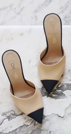 Chanel cap-toe mules - love these cream and black slide-on shoes!