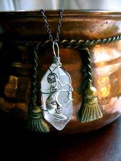 WIRE WRAPPING & crystals. I would use moonstone.