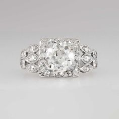 Edwardian Ornate 1.83ct t.w. Old European Cut Diamond Engagement Ring Platinum | Antique & Estate Jewelry | Jewelry Finds Price $7950.00 This regal and rare diamond adorned halo style ring from the 1920's has every element a woman dreams of in an engagement ring! This Edwardian era diamond engagement or anniversary ring features a 1.31ct central GIA certified old European cut diamond with the quality grade of J color, VS2 clarity