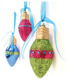 Christmas~Glitter ornaments. Clean bulbs with damp cloth, let dry. Wrap double sided tape around bulb. Roll bulb in glitter. This makes the stripe. Cover rest of bulb with glue then shake different color glitter on glued portion. Let dry. Accent with rhinestones along edge of the stripe. Add a pretty ribbon or just place the finished ornaments in a clear bowl. Very pretty!