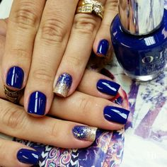 Blue and Gold Glitter Ombre #ombrenails #lucinhabarteli Blue themed washed out gradient nail art design. A rather artsy display of gradient using gold glitter polish gradually declining inwards the nails. Dark blue polish is used as the base coat for this little number.