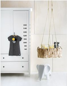 Love the idea of the growth chart as a visual element on a wardrobe. Also in love with that elephant seat - I want one for myself.