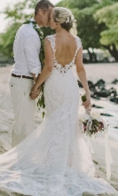 Martina Liana 675: buy this dress for a fraction of the salon price on PreOwnedWeddingDresses.com