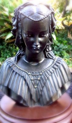 Bust of elegant young woman. Bronzed effect by EvasCollections