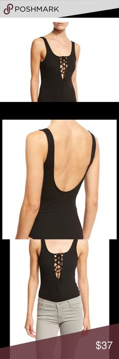 Lucca Couture Lace-up Low Back Sleeveless Bodysuit Lucca Couture jersey-knit bodysuit. V neckline; lace-up detail. Sleeveless; scoop back. Pull-on style. Fitted silhouette. Cotton/polyester. Hand wash. Imported. Lucca Couture Tops Camisoles