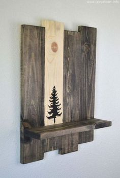 So very unique and beautiful! A reclaimed wood shelf has one unstained panel with a stenciled tree design!