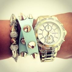 A statement watch makes an even bigger impact with layered bracelets