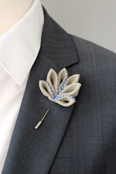 A personal favourite from my Etsy shop https://www.etsy.com/listing/237013743/maple-leaf-lapel-pin-mens-lapel-flower