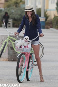 Ambrosio rode a bike with her dog during a #Victoria'sSecret photo shoot