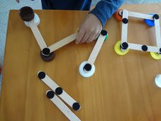 Geometry in action.  Velcro and craft sticks to make shapes.  Trace afterward for following verbal instructions and fine motor control.