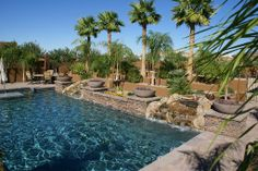 Luxury pool design with rock and fire features.