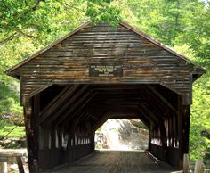This shot is of an old covered bridge originally built in 1858 that is located in the White Mountain National Forest in New Hampshire .