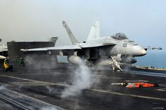 An F/A-18E Super Hornet from the Tophatters of Strike Fighter Squadron (VFA) 14 launches from the aircraft carrier USS John C. Stennis (CVN 74).