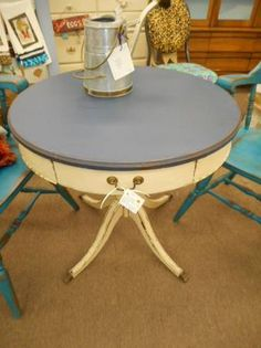 $90 - Shabby round Mersman parlor table creamy white distressed base with navy blue top. One drawer for storage. ***** In Booth D8 at Main Street Antique Mall 7260 E Main St (east of Power RD on MAIN STREET) Mesa Az 85207 **** Open 7 days a week 10:00AM-5:30PM **** Call for more information 480 924 1122 **** We Accept cash, debit, VISA, Mastercard, Discover or American Express