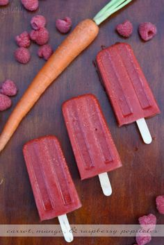 Carrot, mango, & raspberry popsicles by @girlichef