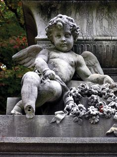 Cherubs and floral sprays are common Victorian-era embellishments on monuments…