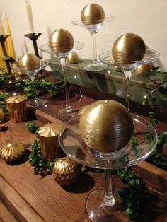 """GOLD CANDLE  from 7.00 These funky Gold Ball Candles look dramatic on our exquisite Glass Pedestals or simply tucked among berries and greens.  4"""" Diameter or 2"""" Diameter"""