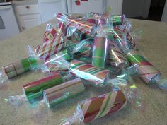 Re-purposed toilet paper rolls into Old-fashioned Christmas candy - string them together for an awesome garland!
