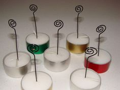 Card holders in a pinch ~ make and insert spiral-twisted wires into tea lite candles.  These can be used for place cards, buffet food markers, a display of photos - etc.  After the event, just remove the wires and save the tea lites.