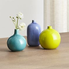 Shop Perry Vases. Fired at two different temperatures to achieve its textured look, the handcrafted vase is cloaked in a stunning glaze.