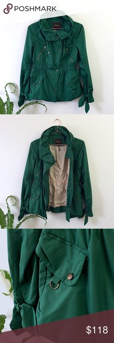 Cole Haan green jacket Beautiful water resistant jacket with ties at the cuffs. Cinched waist, snap buttons, and hidden hood in the collar. Perfect condition. Width: 18.5 inches, length: 25 inches. Cole Haan Jackets & Coats