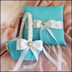 Tiffany Blue Wedding Flower Girl Basket and Ring Bearer Pillow Set, Tiffany blue and white, Wedding Ceremony Accessories. $75.00, via Etsy.