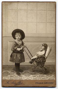 Girl With Pram And Doll by josefnovak33, via Flickr